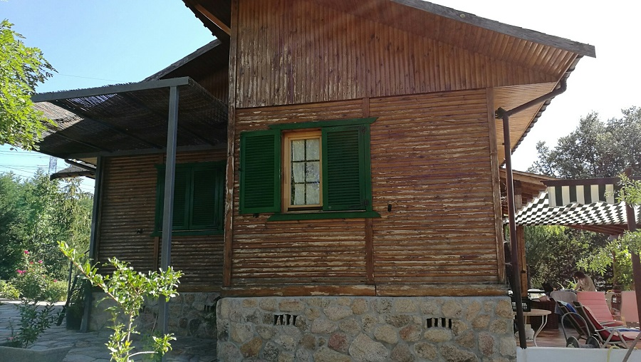 casa de madera en Guadarrama antes de pintar con Gaina